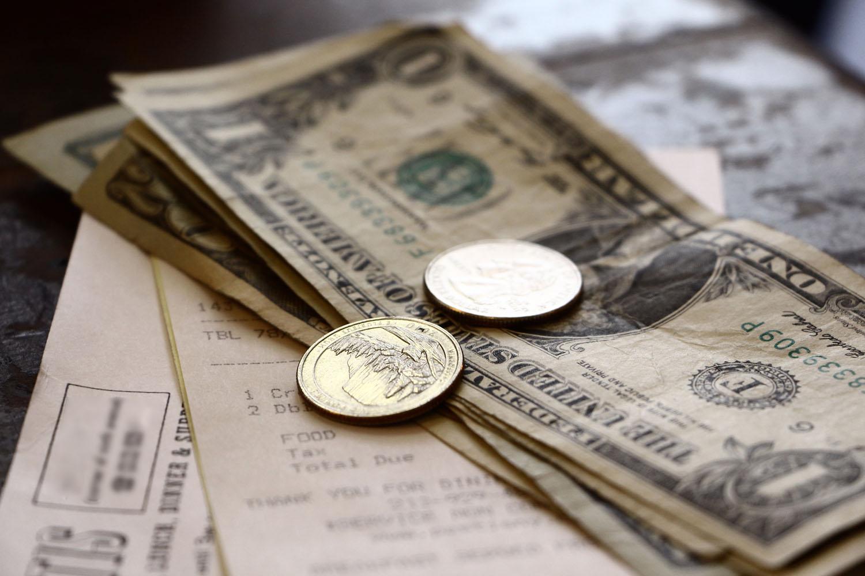Tip sitting on a restaurant receipt.