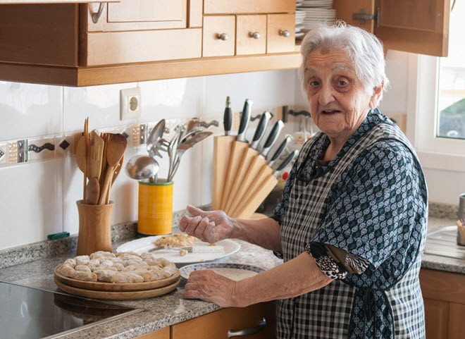 Elderly Woman Cooking in the Kitchen.