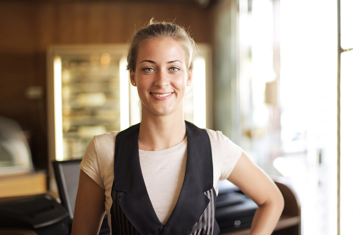Young waitress smiling for the camera.