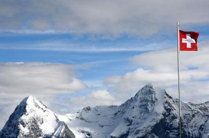 swiss flag on a mountain